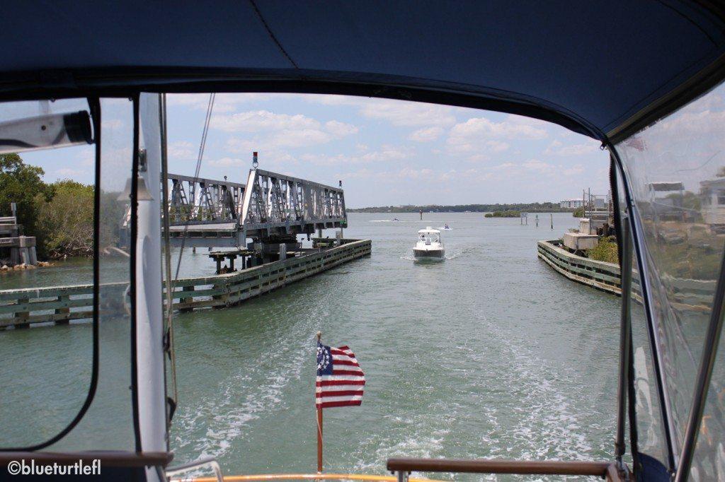 trawler driving through swing bridge