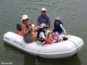 dingy boat with 4 people and dog