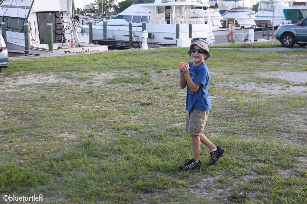 Corey playing catch with his daddy