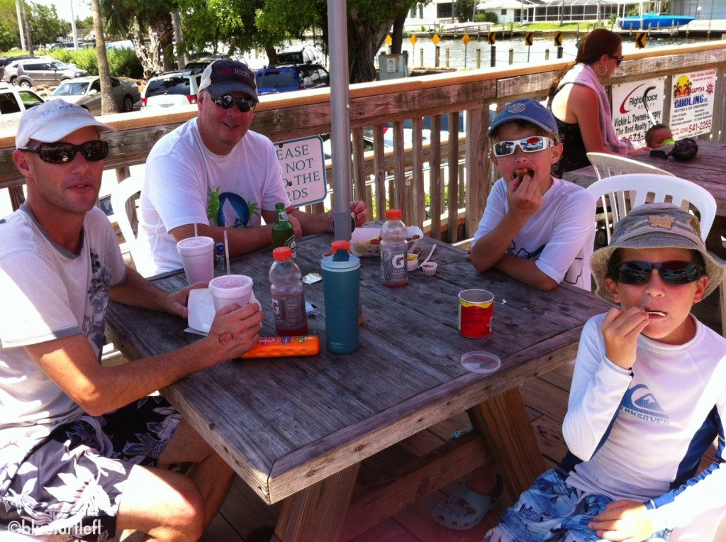 "Randy, his friend Rob, Rob's son Reef, and Corey having lunch at KC's by the Cape Coral ""beach"""