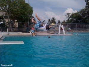 Randy's son, Corey, flipping off the diving board at the pool