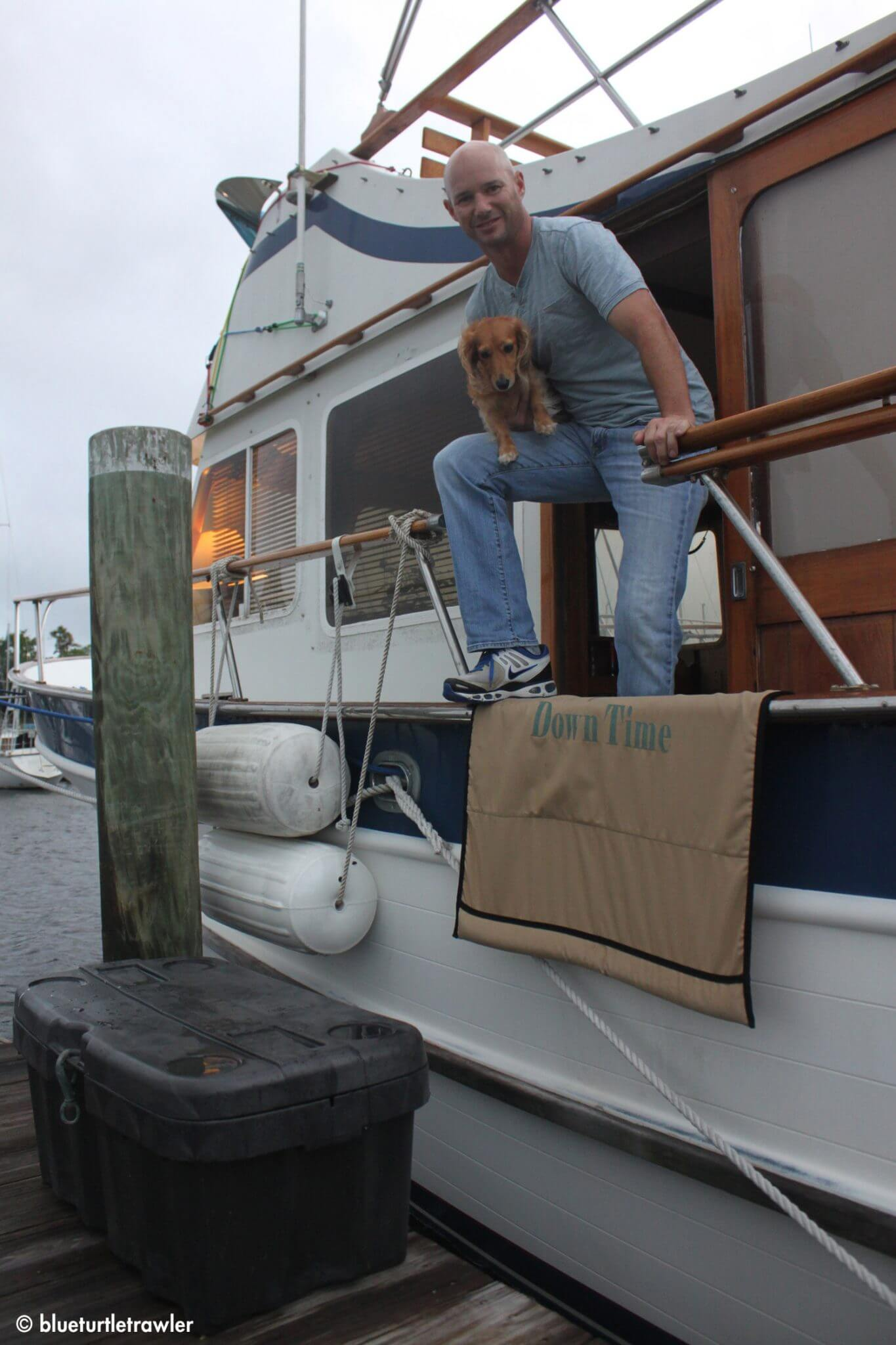 Randy (with Sophie) using a dock box to get down from the boat