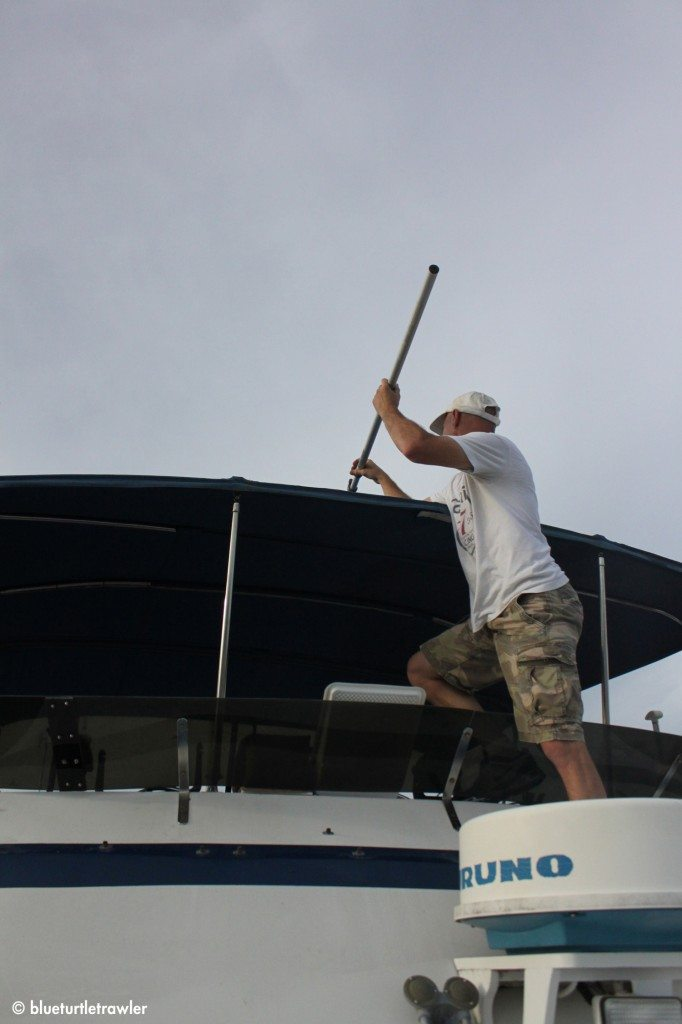 Randy applying the waterproofing solution to the bimini
