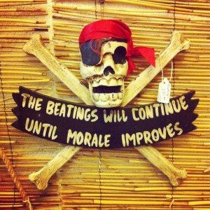 Nautical decor like this sign can be found at Mariner's Trading Company