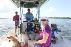 Our gang on Rob's boat heading to the beach