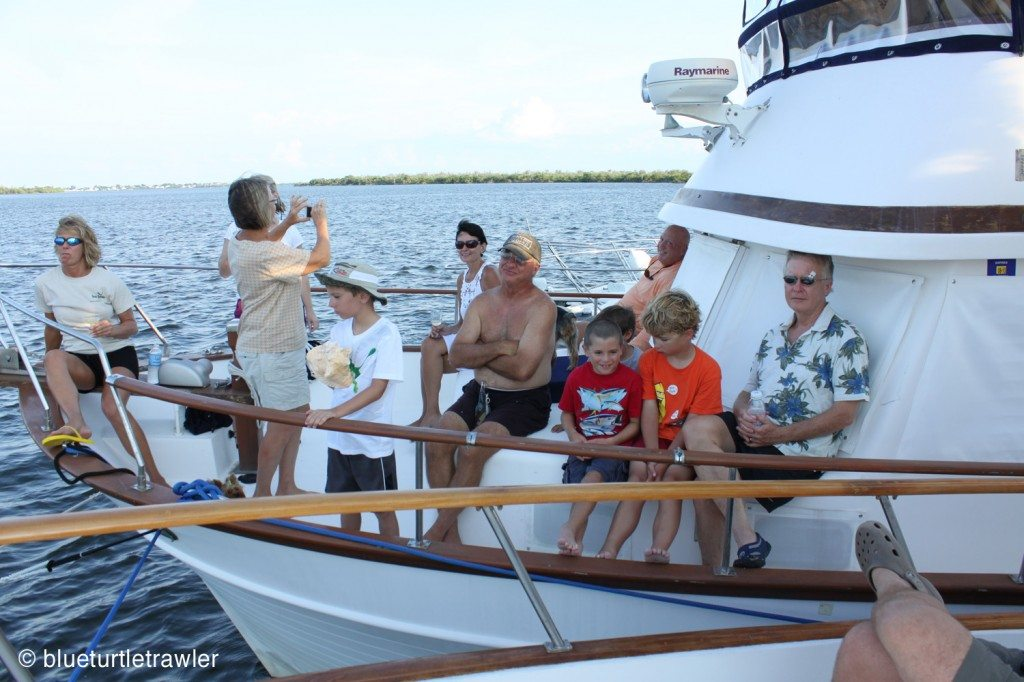 Friends and family on the bow of Island Time taking in the two ceremonies