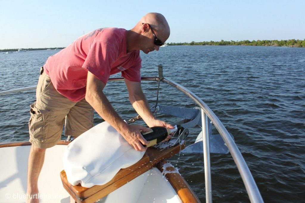 Capt. Randy pour champagne onto the bow and hull