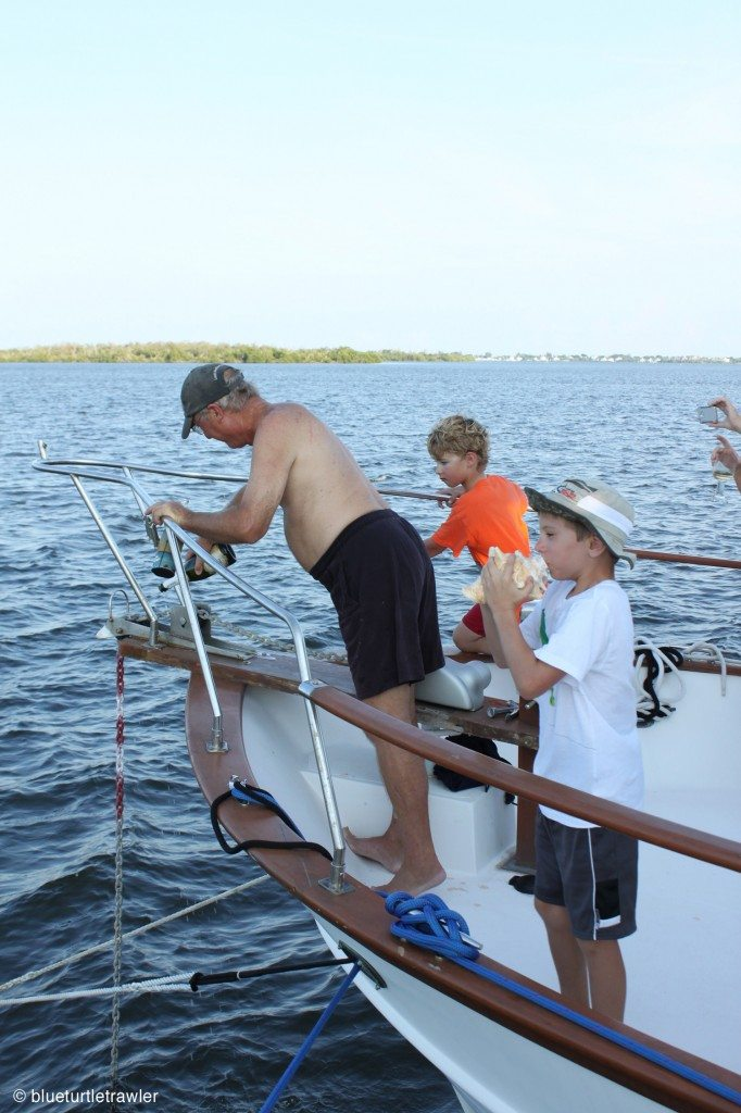 Capt. Steve pouring champagne on the bow of Island Time