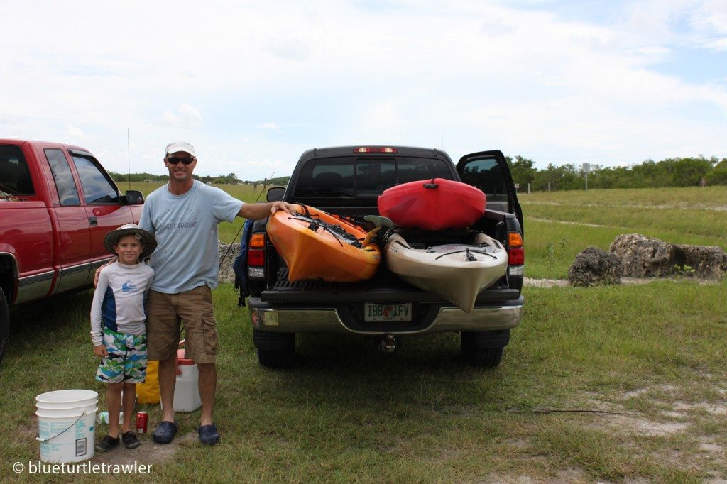 Randy and Corey next to the truck loaded with kayaks