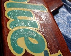 """White lettering yellowed by the Flagship Varnish and the """"alligator skin"""" texture"""
