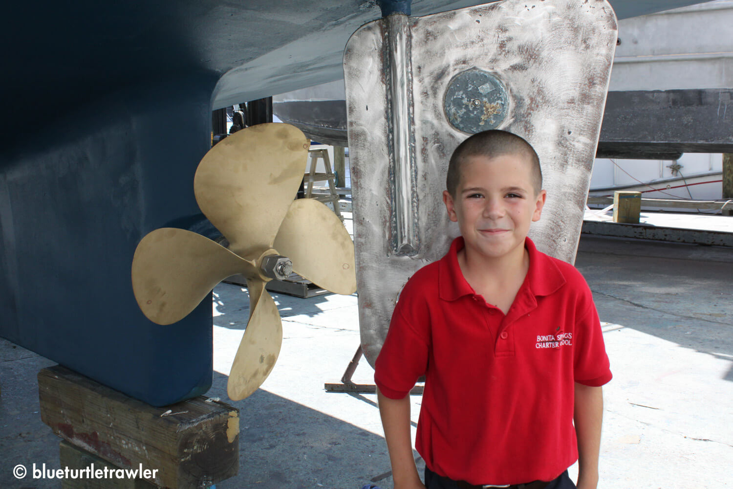 The boy (with fresh haircut) with the shiny prop and rudder