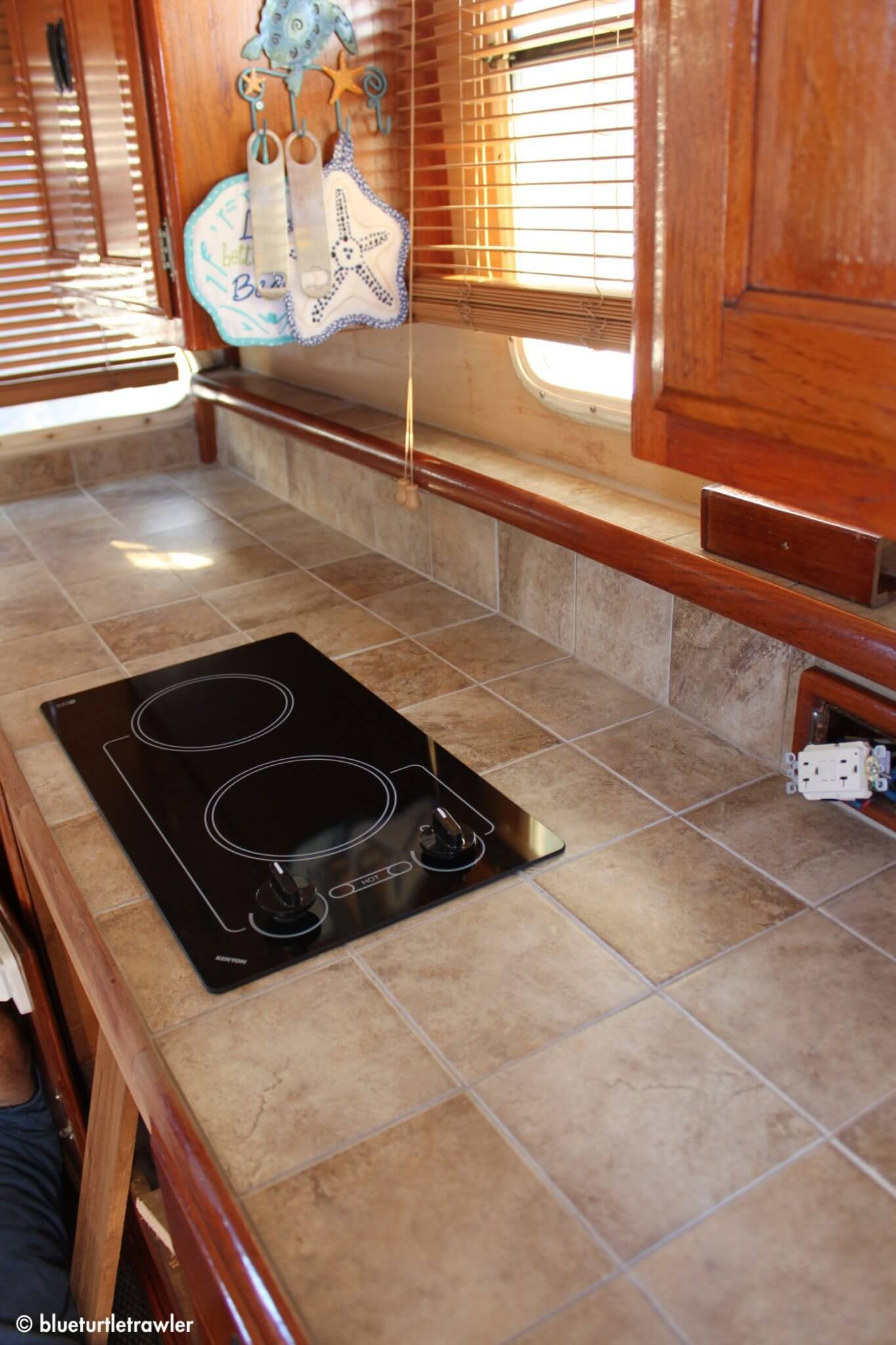 AFTER: The cooktop is dropped in and hooked up the next day