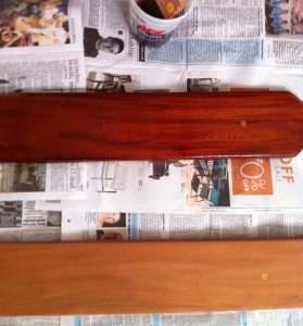 The bare wood (bottom) name board and one varnished with Captain's Varnish (top)