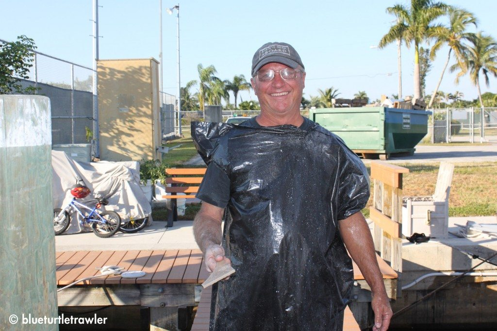 Captain Steve (Dad) dons a garbage bag once again to repel the wet saw water