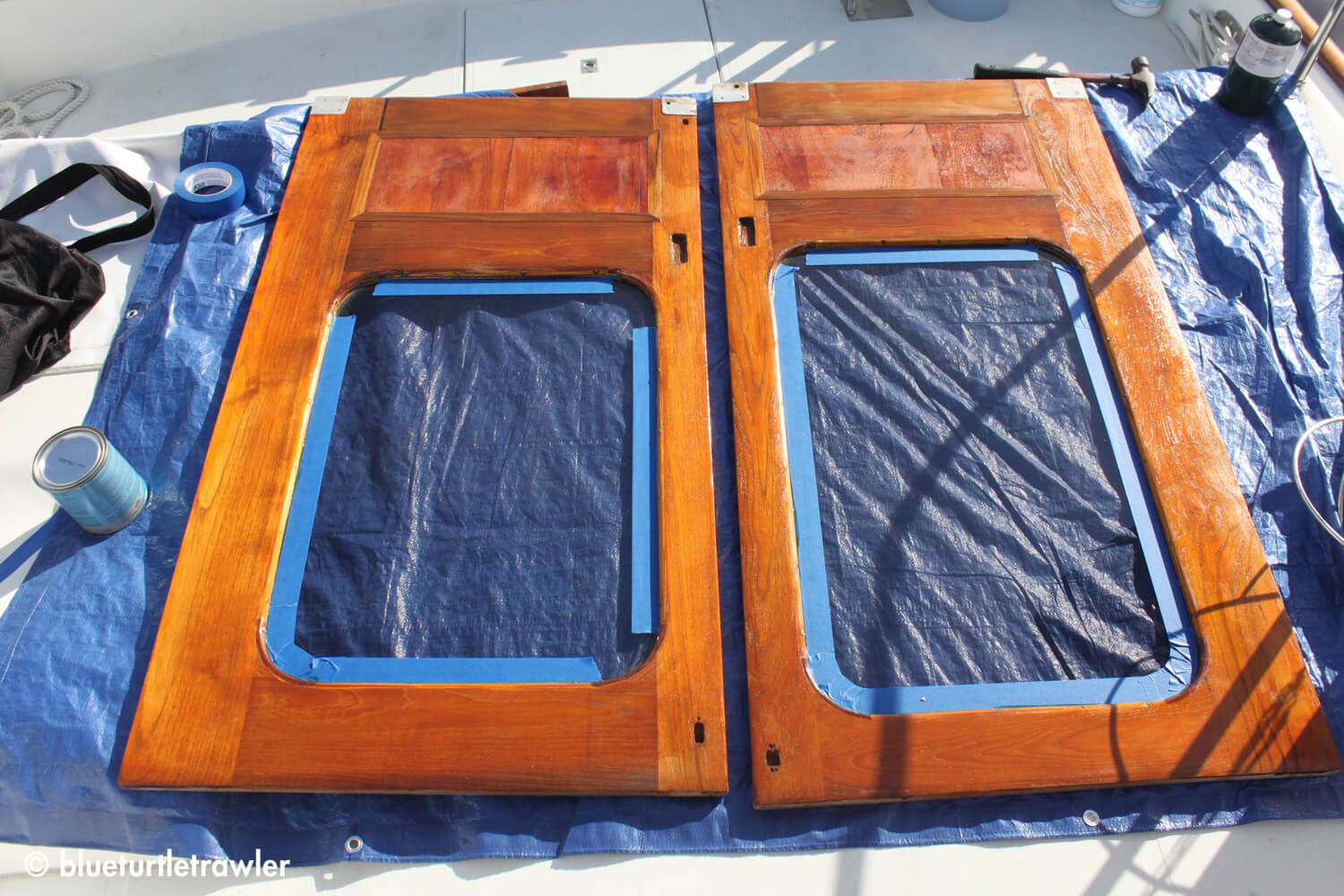Doors after first coat of Cetol...and yes, I was too lazy to tape the rounded window corners