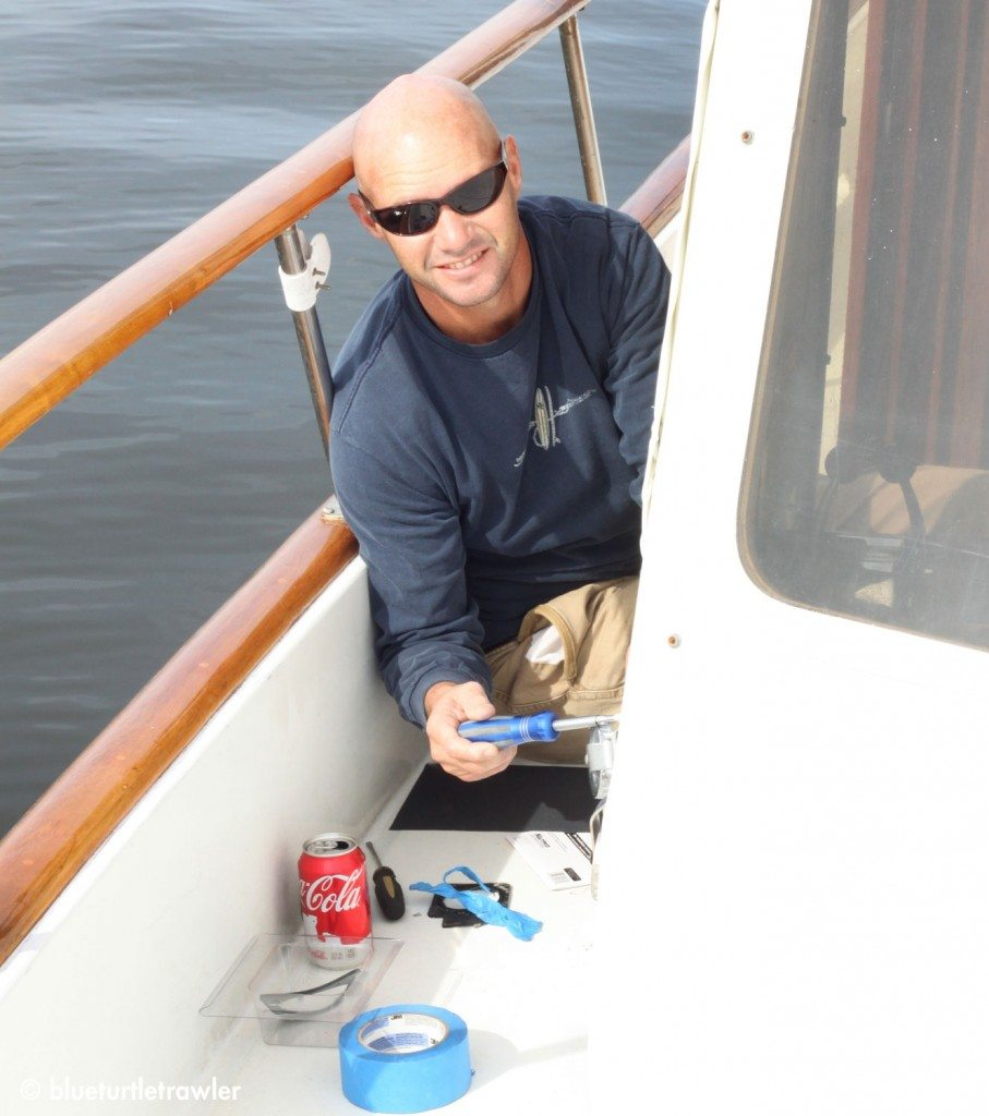 Randy replaces one of our electric outlets on the boat