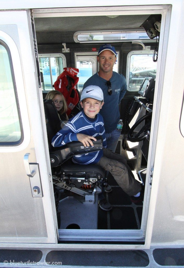 Corey got to sit in the Captain's seat of the Coast Guard boat