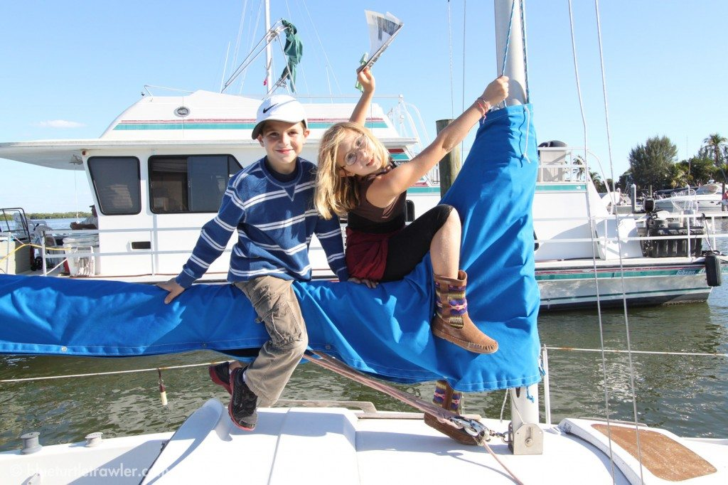 Corey and Maddie playing on Mary Kay's sailboat