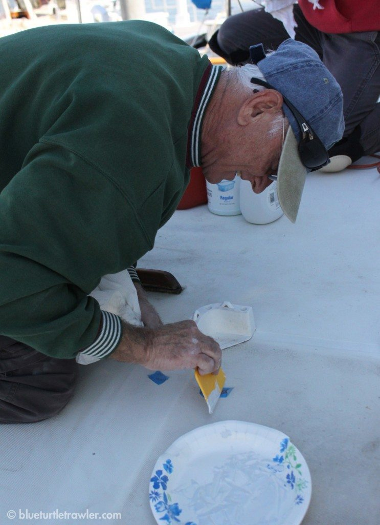 Randy's father, John, patching areas of the fiberglass