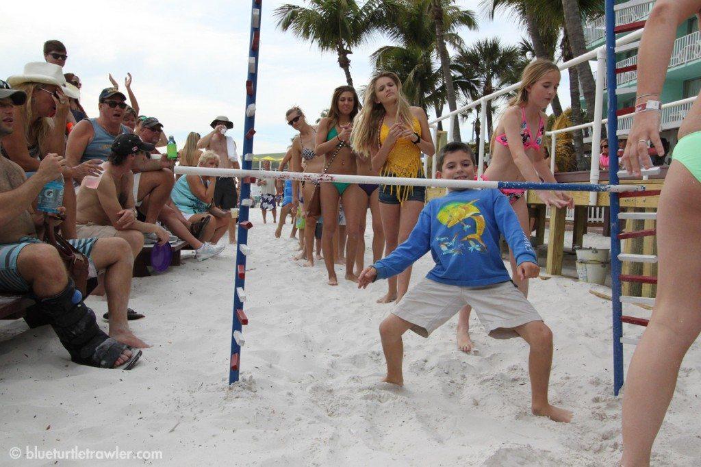 Corey ducking under the limbo pole