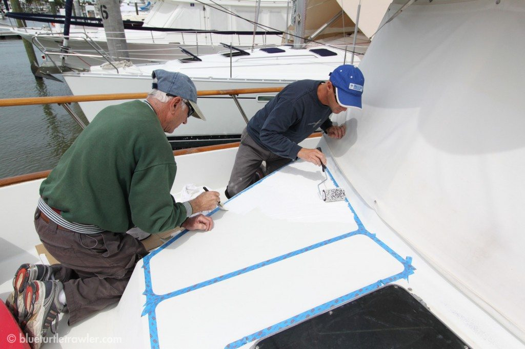 Once the deck areas are taped off, they began to KiwiGrip