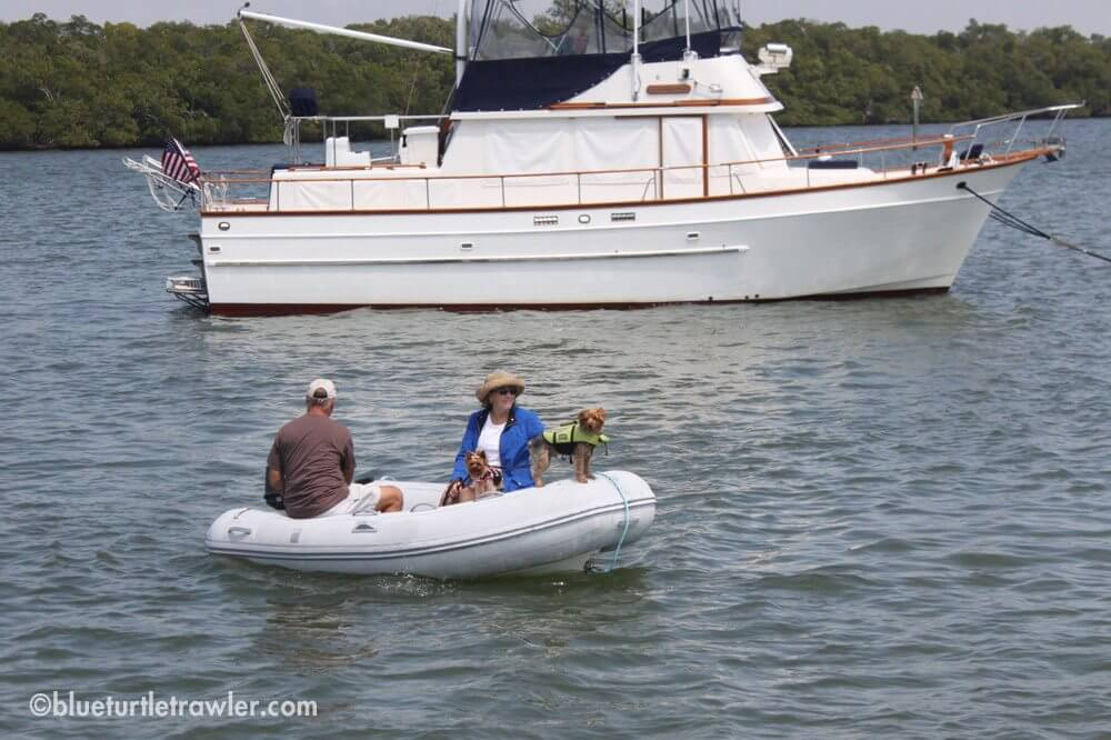 Capt. Steve and Gina (my parents) with their pups heading to Mantanzas Inn to register their mooring ball