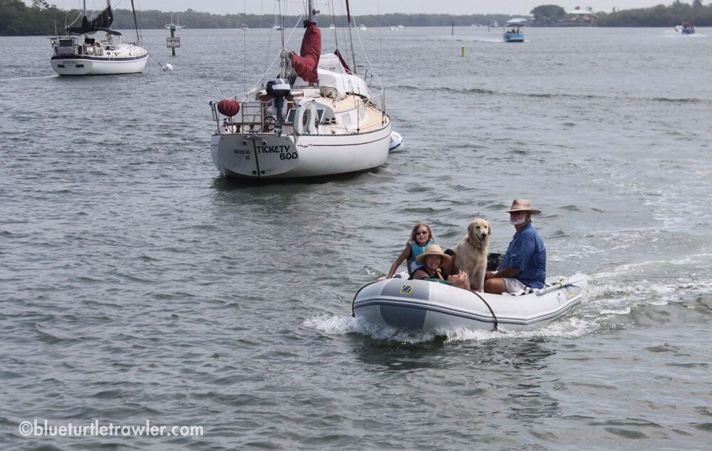Friends Tom, Mary Kay and Maddie with Baily arriving by dinghy
