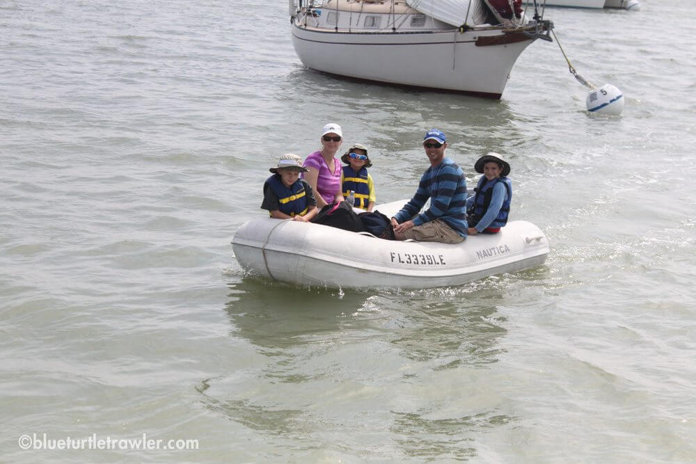 My sister and nephews arriving by dinghy