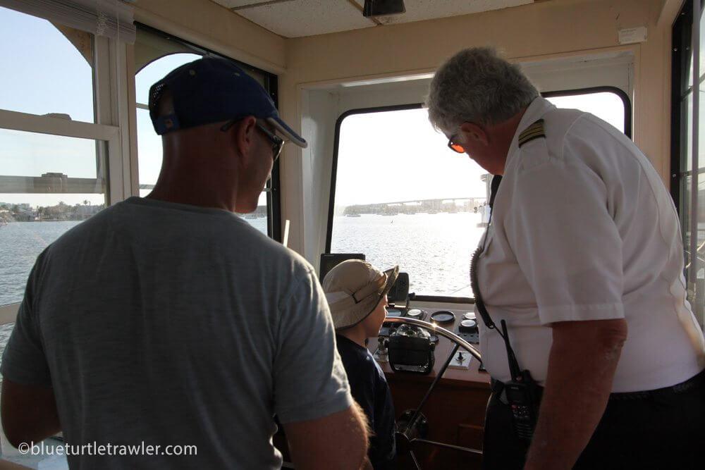 Captain Kevin shows Corey and Randy around the wheelhouse