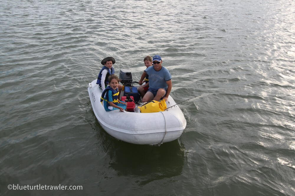 Randy and the boys on their dinghy ride