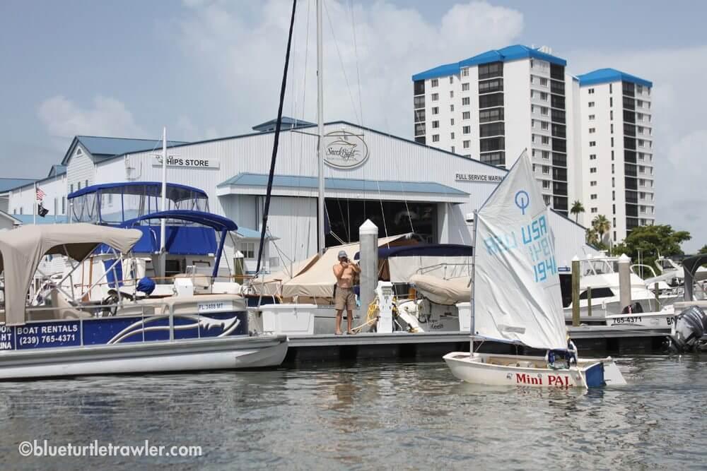 Corey buzzes the marina (Snook Bight) while Tim takes his photo