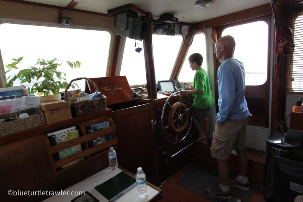Corey and Randy captain Blue Turtle from the lower helm in the comfort of the air conditioned cabin