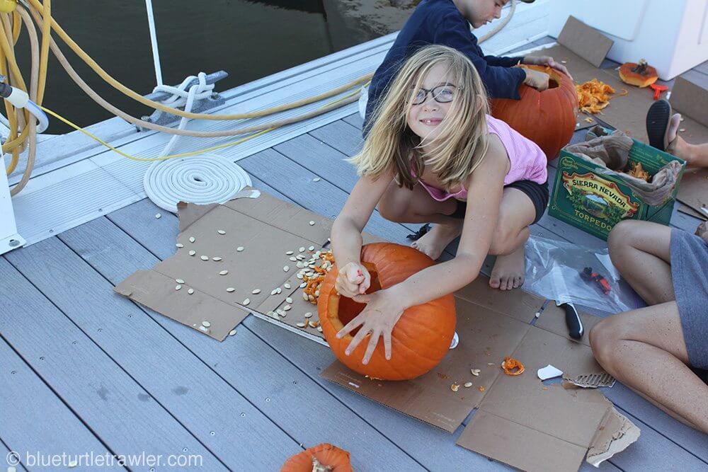 Maddie working on her pumpkin carving