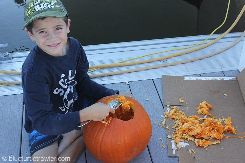 Corey worked on getting the seeds out go his pumpkin
