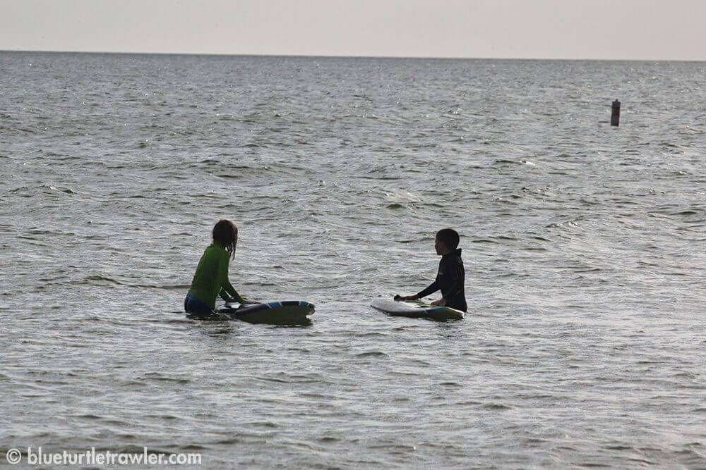 Two little surfers