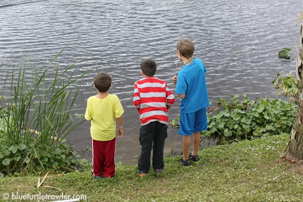 The boys playing with a remote control boat