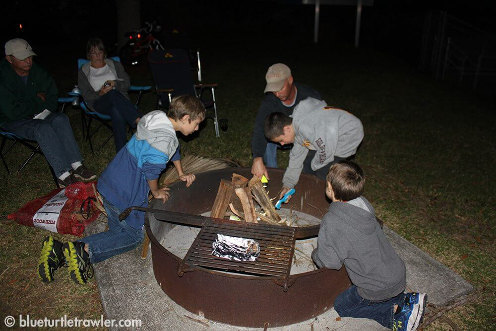 Randy and his helpers build the bon fire