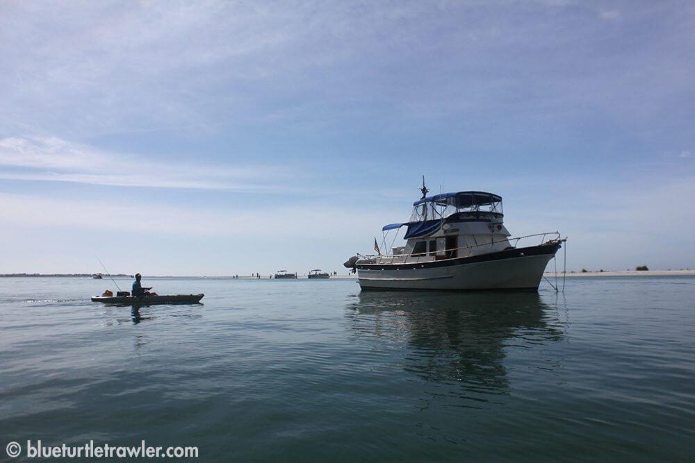 Blue Turtle anchored at Keewaydin and Randy paddling his kayak