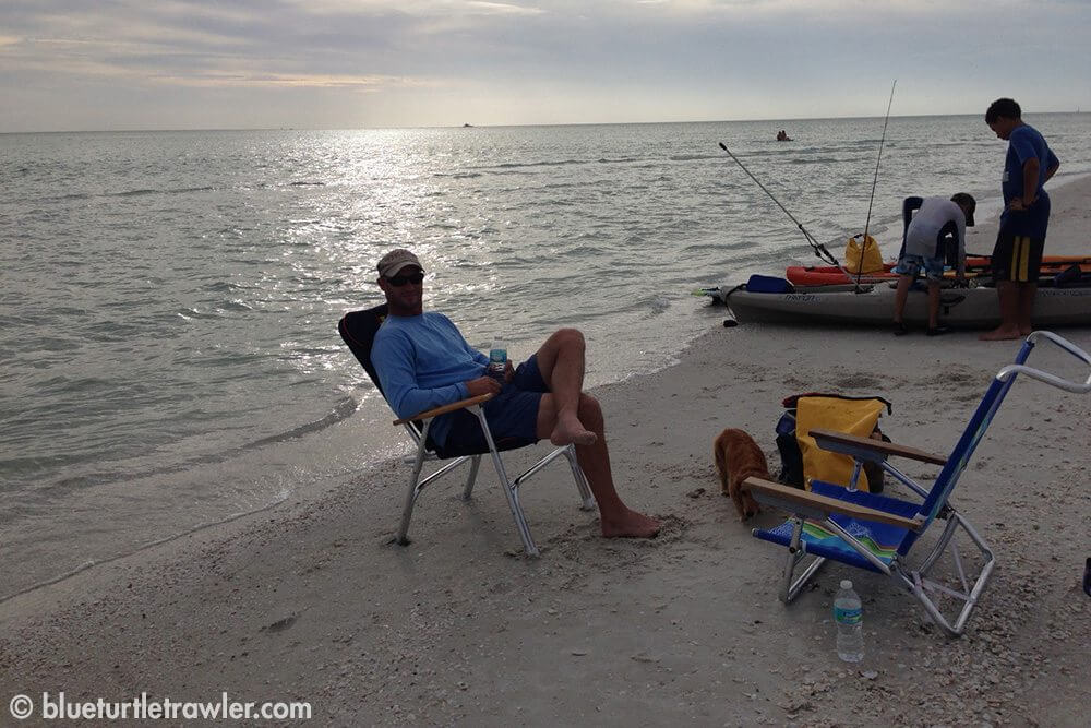 Randy relaxing on the beach while Corey and another boy on the beach talked fishing and kayaks