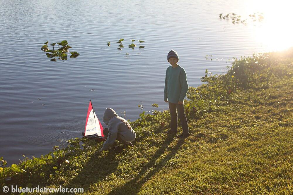 Corey and Jack sail the new new remote control sailboat in the fresh water