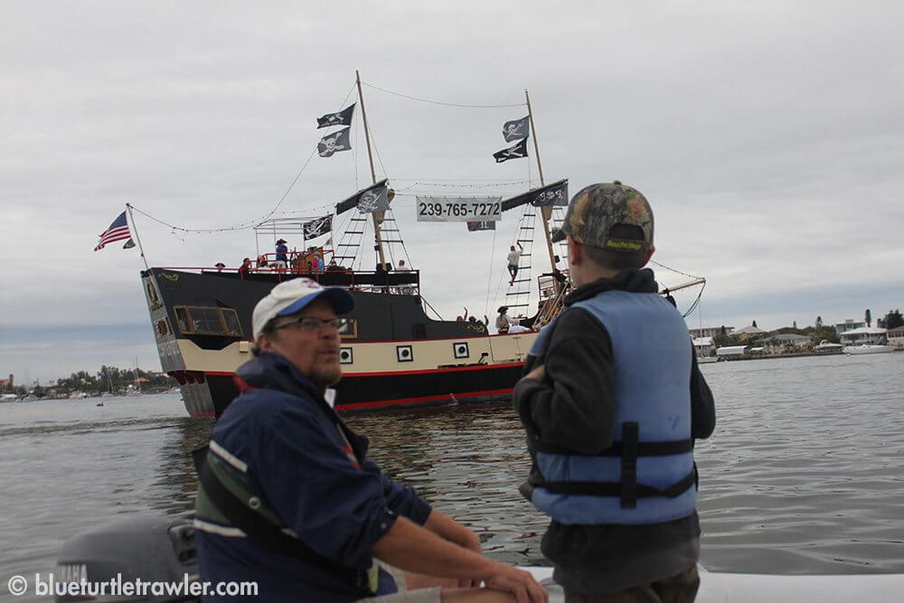 """Mike and Corey with the pirate ship, """"Pieces of Eight"""", behind them"""