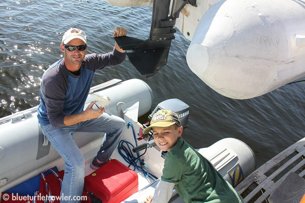 Randy and Corey put the fixed prop on the dinghy