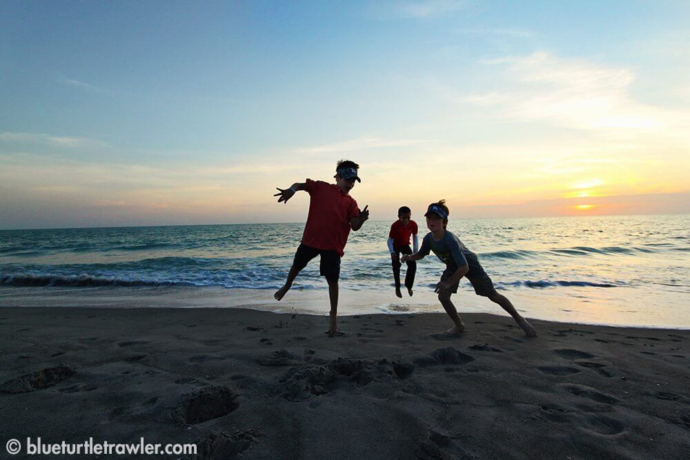 Ashton, Corey and Harry playing on the beach