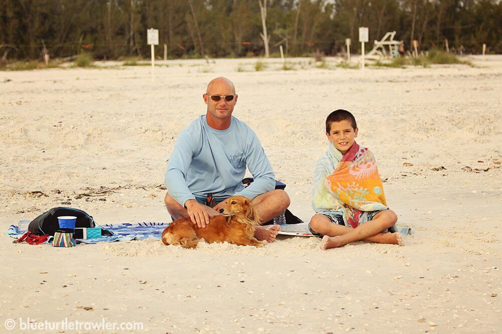 Corey takes a break from skim boarding to pose with Randy and Sophie