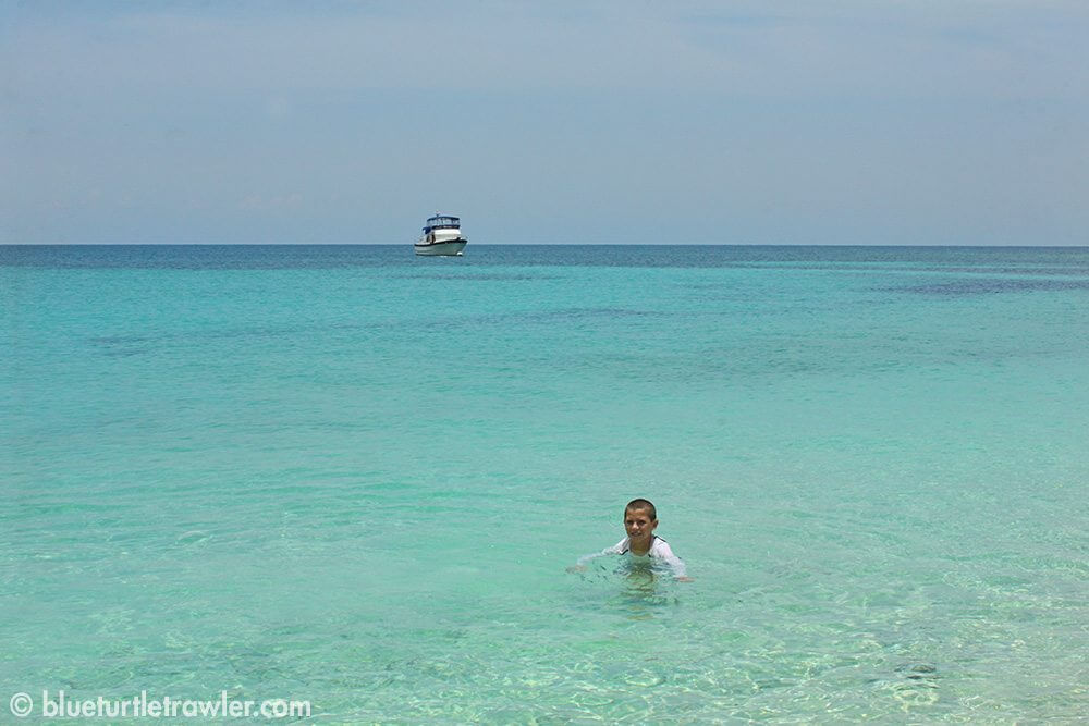 Corey swims in the crystal water