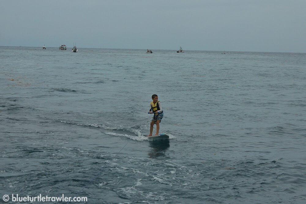 Corey goes trawler surfing on our way to Marathon