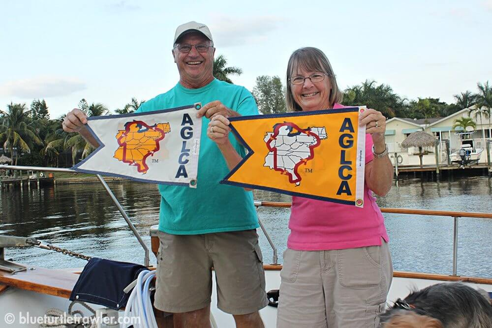Steve and Gina posing with their Looper flags