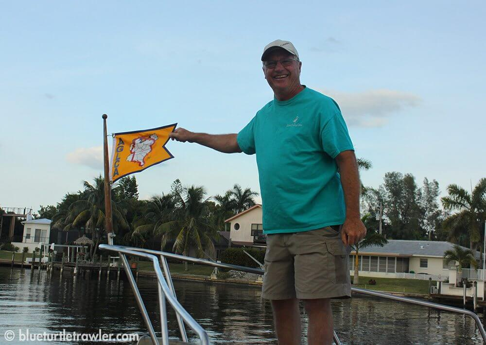 Captain Steve changes the burgee to the Gold Looper flag signifying the completion of the Great Loop