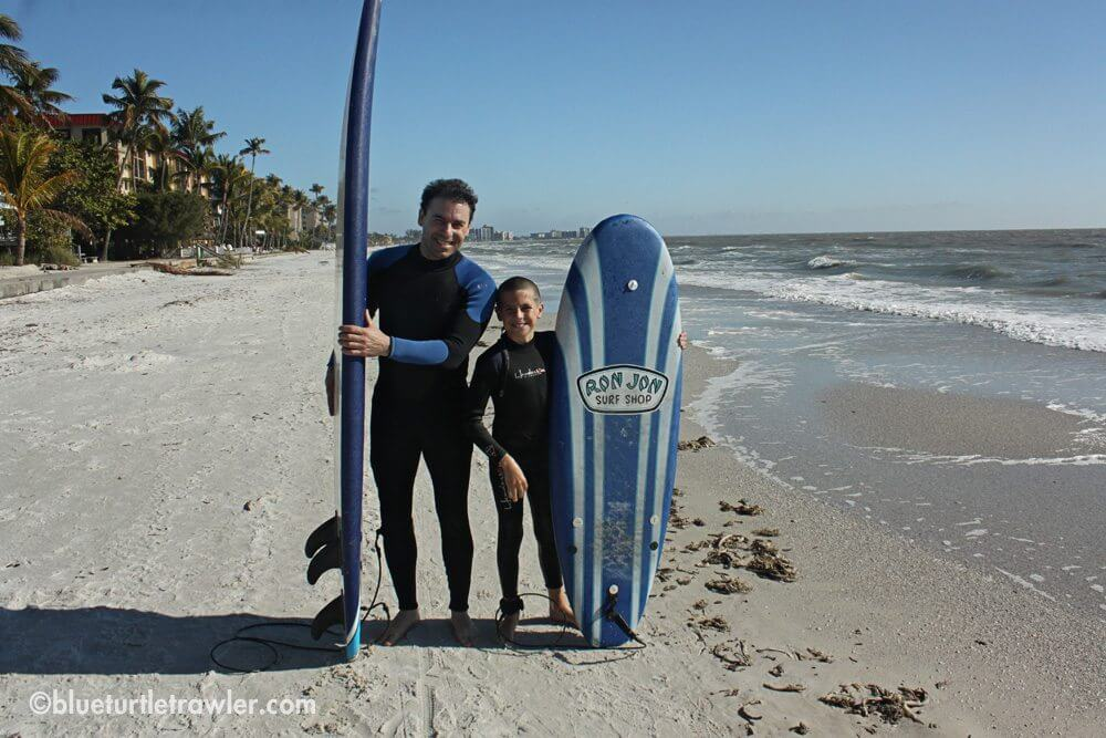 Corey surfing with his Uncle Scott