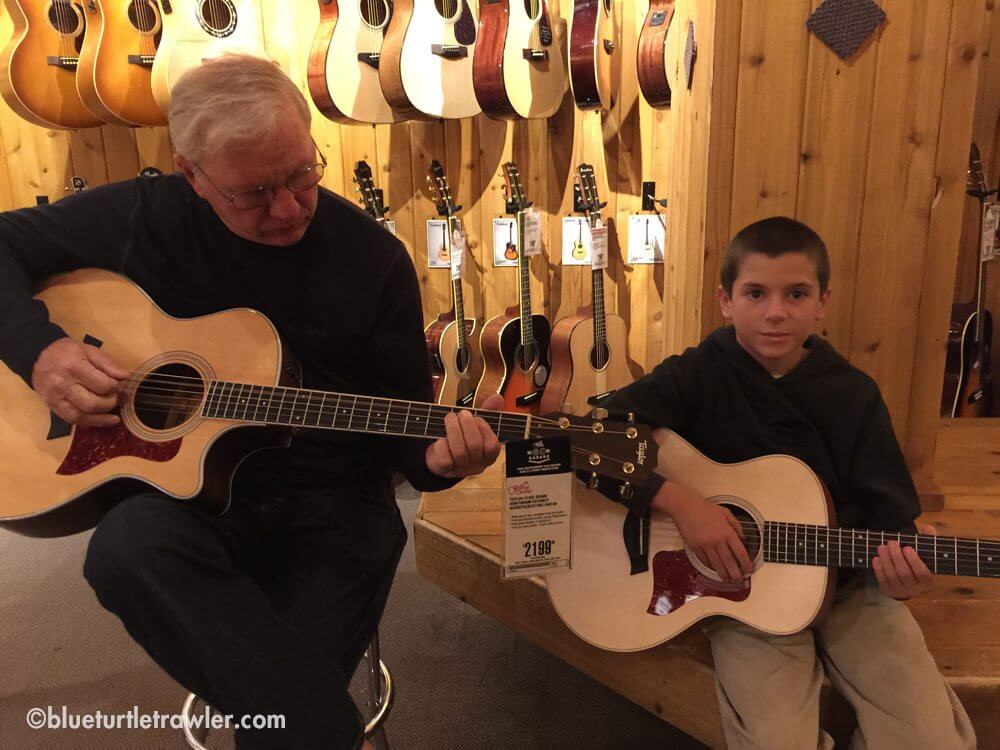 Grandpa Steve and his mini me trying out some guitars
